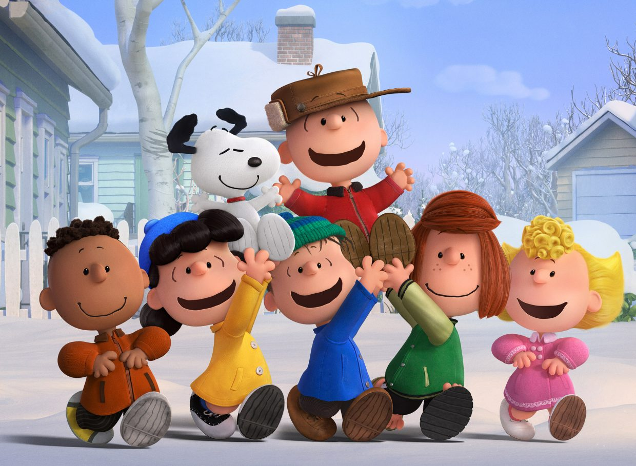 """The gang celebrates a snow day in """"The Peanuts Movie."""" The movie is an update of Charles M. Schulz's classic comic strip about Charlie Brown, Snoopy and their group of friends."""
