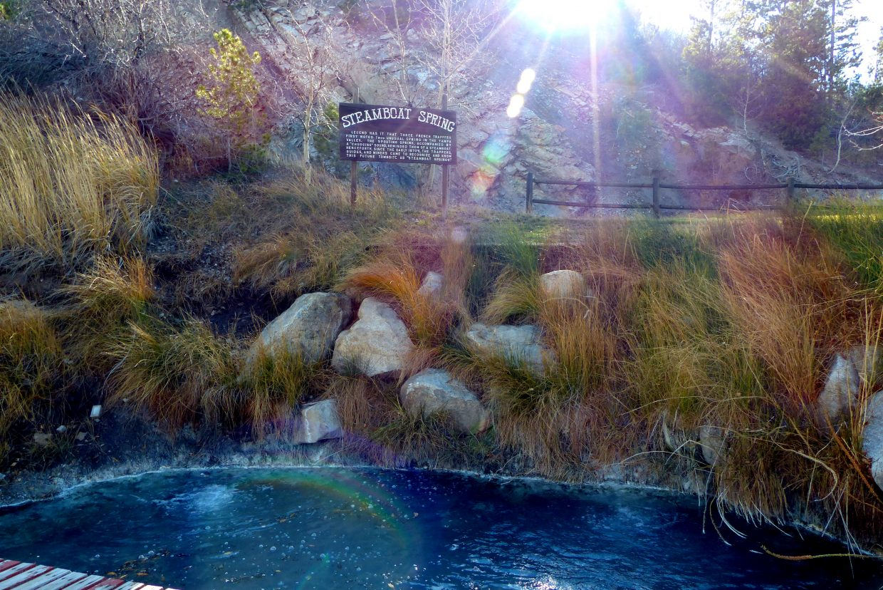 The sun was setting behind the original Steamboat Spring, along the Yampa River near the Bud Werner Memorial Library. In the 1870s, the fur trappers in the area heard a chugging sound along the Yampa River which resulted in the name of the town of Steamboat. When the railroad came to town, the rocks were rearranged and the sound went away. Submitted by: Shannon Lukens