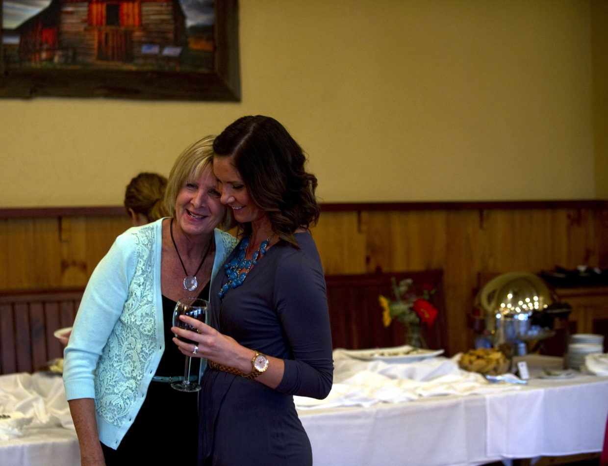 Jane Toothaker enjoys a moment with her daughter, Jessica Rotan, on Friday evening at Catamount Ranch & Club, where Toothaker celebrated her July retirement after serving the Northwest Colorado Board of Cooperative Educational Services for more than 30 years.