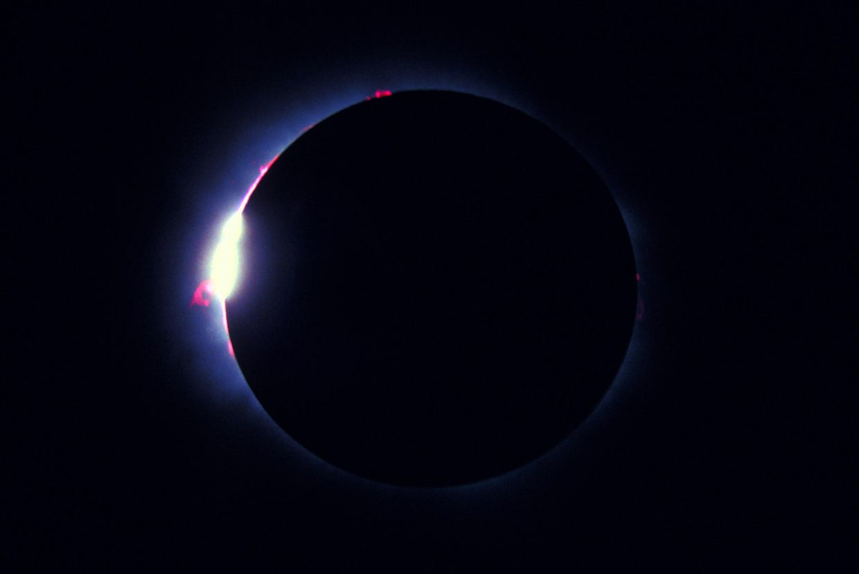 The so-called Diamond Ring effect signals the beginning and the end of totality, when the light from the sun's blinding photosphere streams through deep craters along the edge of the moon. The pink protrusions are colossal flame-like clouds of hot hydrogen gas, called prominences, leaping off of the sun. This image was taken during the total eclipse of the sun on July 11, 1991, from near Cabo San Lucas, Mexico.
