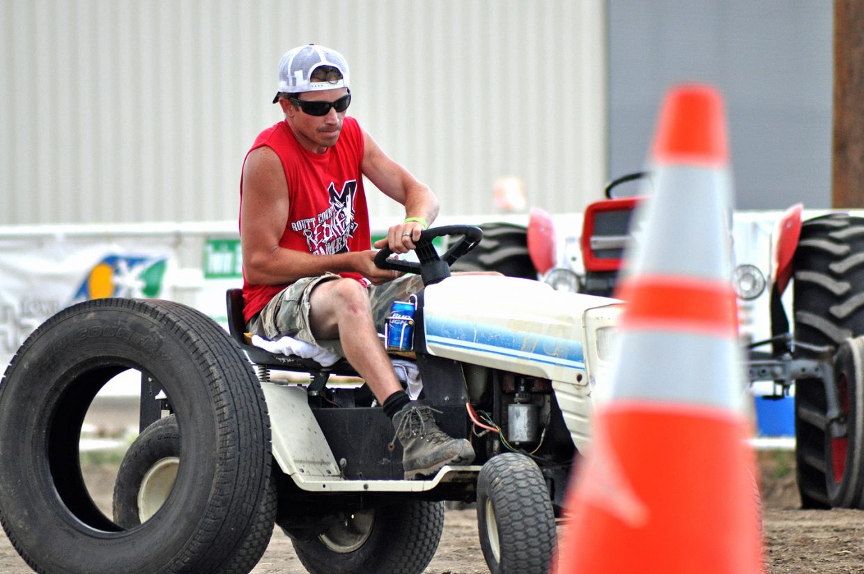 Travis Mathey weaves this lawnmower through the obstacle course portion of the Lawnmower Triathlon at the 2014 Routt County RedneX Games in Hayden, Colorado. Travis ultimately ended up placing second. Submitted by: Wendy Lind