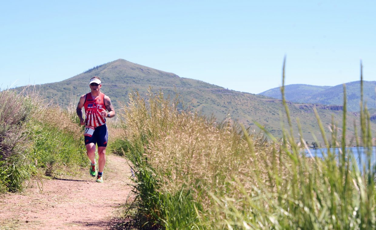 Shawn Saunders climbs down the final stretch of the Olympic section of Sunday's Tri the Boat triathlon at Stagecoach State Park.