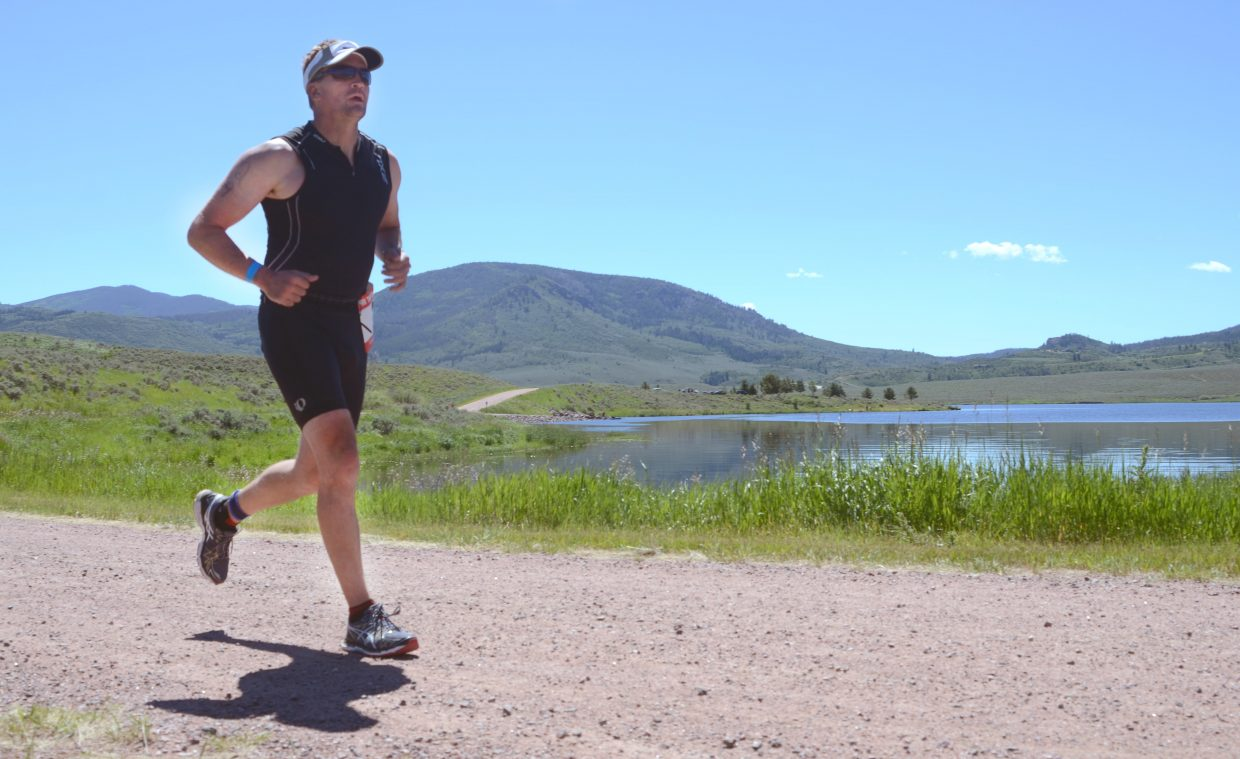 Grant Warfield heads into the final mile of the Olympic section of Sunday's Tri the Boat at Stagecoach State Park.