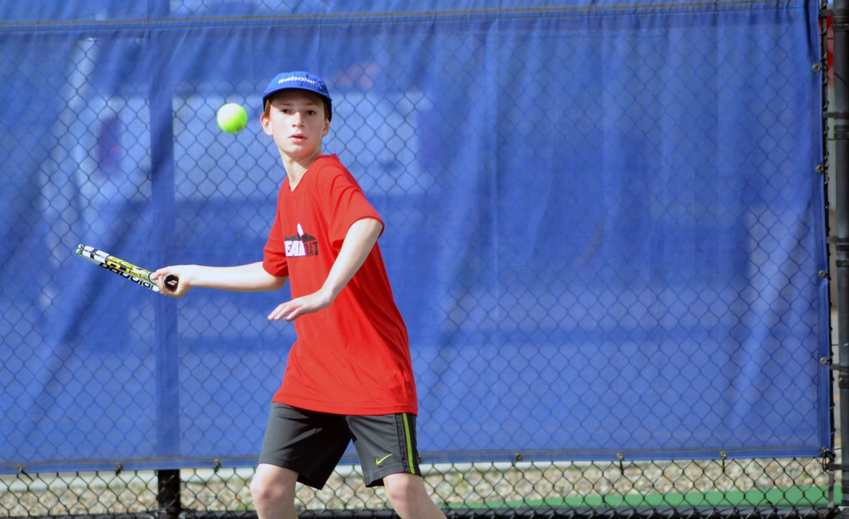 Steamboat Springs' Cedar Turek returns a shot in his boys consolation quarterfinal Sunday in the 21st annual Intermountain 12 and Under Tennis Championships at the Tennis Center at Steamboat Springs. The champions bracket will wrap up Monday morning.