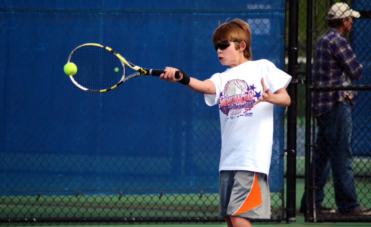Lucas Sands rallies with opponent Cedar Turek in the boys quarterfinal of the consolation bracket at Sunday's 12 and Under Tennis Championships at the Tennis Center at Steamboat Springs.