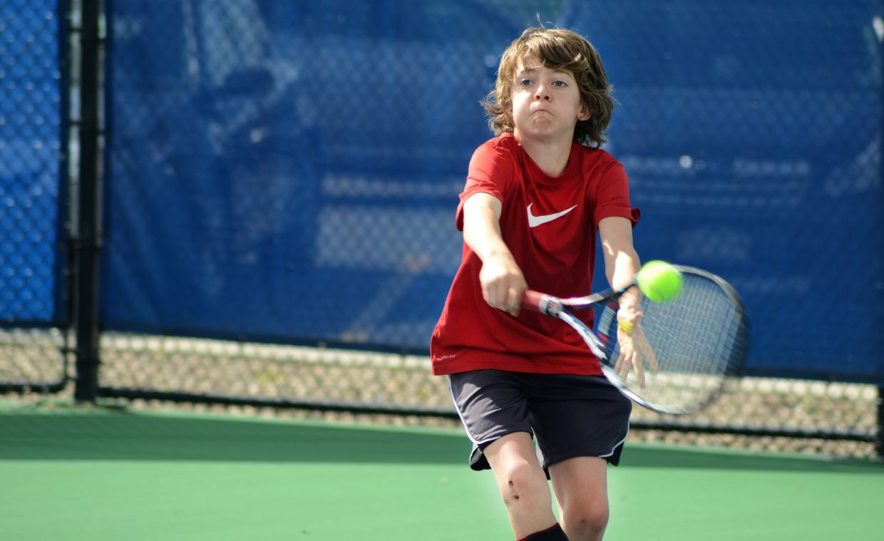 Wyatt Stempel lays down a shot in his match against Roy Lundeen in Sunday's round of the 21st annual Intermountain 12 and Under Tennis Championship at the Tennis Center at Steamboat Springs.