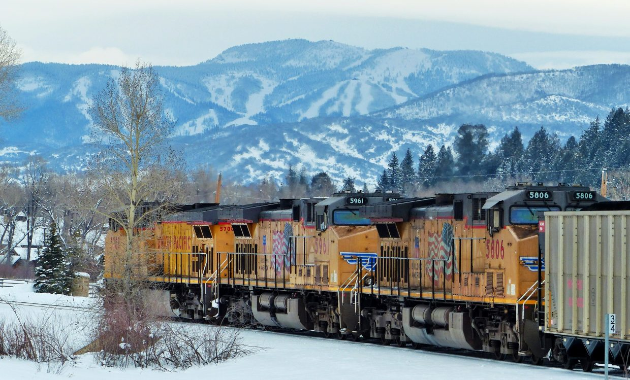 The Union Pacific rolled through Steamboat and stopped on the west end of town, with the slopes of the ski area in the background. Submitted by: Shannon Lukens