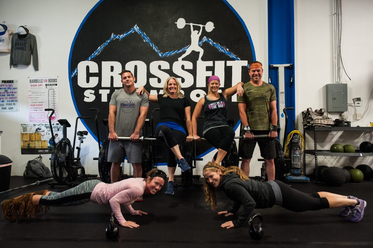 Ian Fraser and Kris Mann hold up Julie Keyek and Toria Kuntz on their barbell while Becky Kuhl and Jaime Weinress show off their planks. Crossfit Steamboat members want the public to join them this Saturday morning for a fun workout to raise money for breast cancer with the Barbells for Boobs fundraiser.