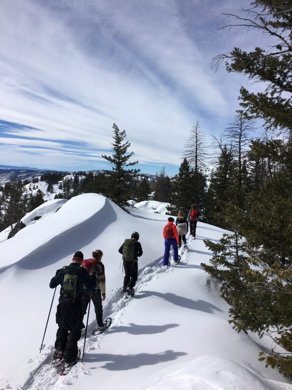A group snowshoes up Steamboat Springs' Uranium Mine trail near Fish Creek Falls.