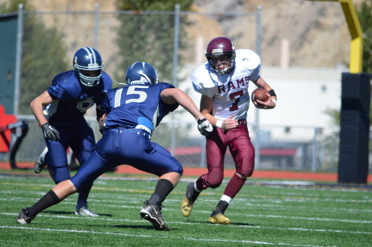Matt Regan, right, plays in Saturday's game against Vail Christian.