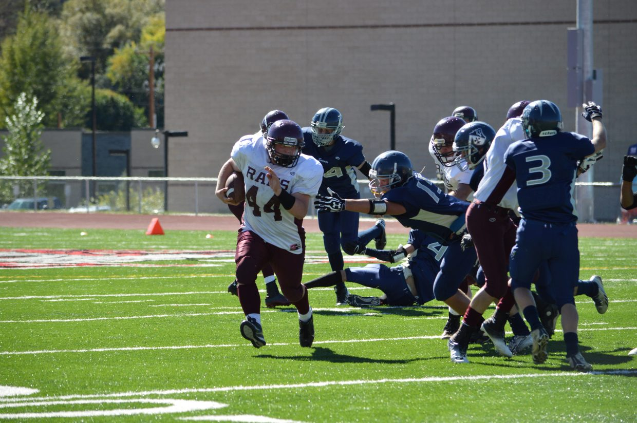 Ian Palyo, left, plays in Saturday's game against Vail Christian.