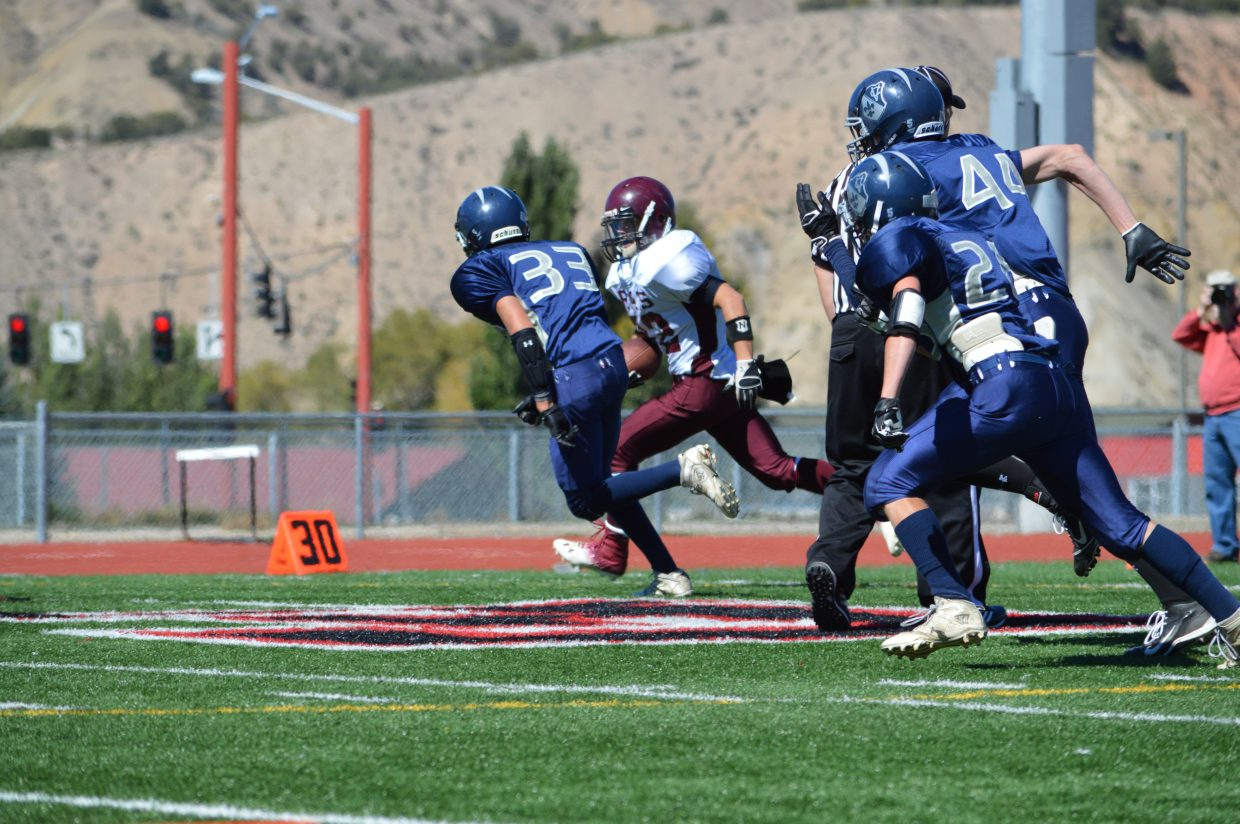 Storm Veilleux, center, plays in Saturday's game against Vail Christian.