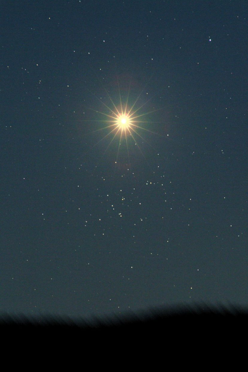 Early risers on Sept. 1 can watch the dazzling Morning Star, Venus, pass by the sparkling Beehive Star Cluster, with the help of binoculars or a small telescope. This image captured a similar passage on June 20, 2010.