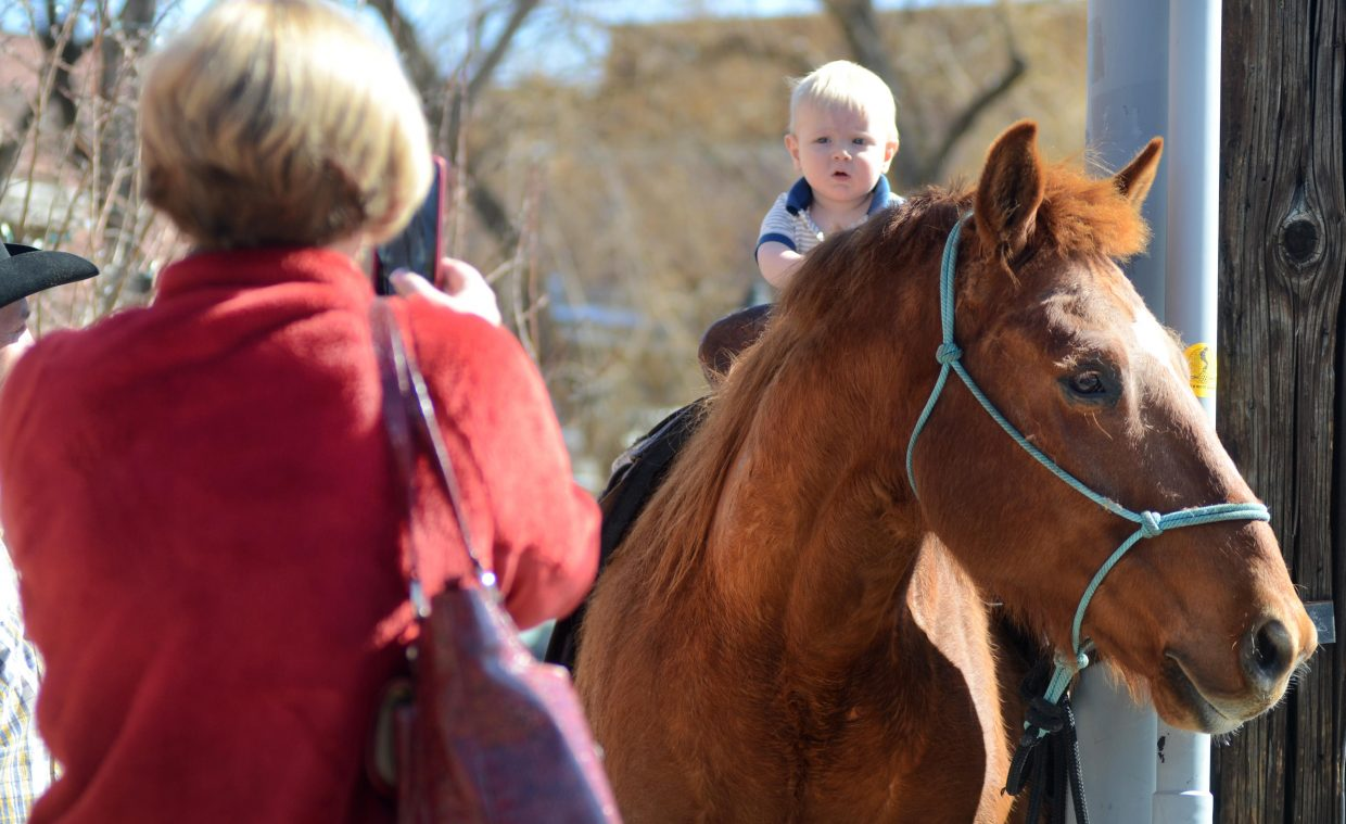 Nolan Dempsey got a little flashback to Steamboat Springs' early days with a ride on 8-year-old Jack in downtown on Sunday. Jack's owner rode the horse in from West Steamboat for the day and parked the steed on the corner of Seventh and Yampa streets.