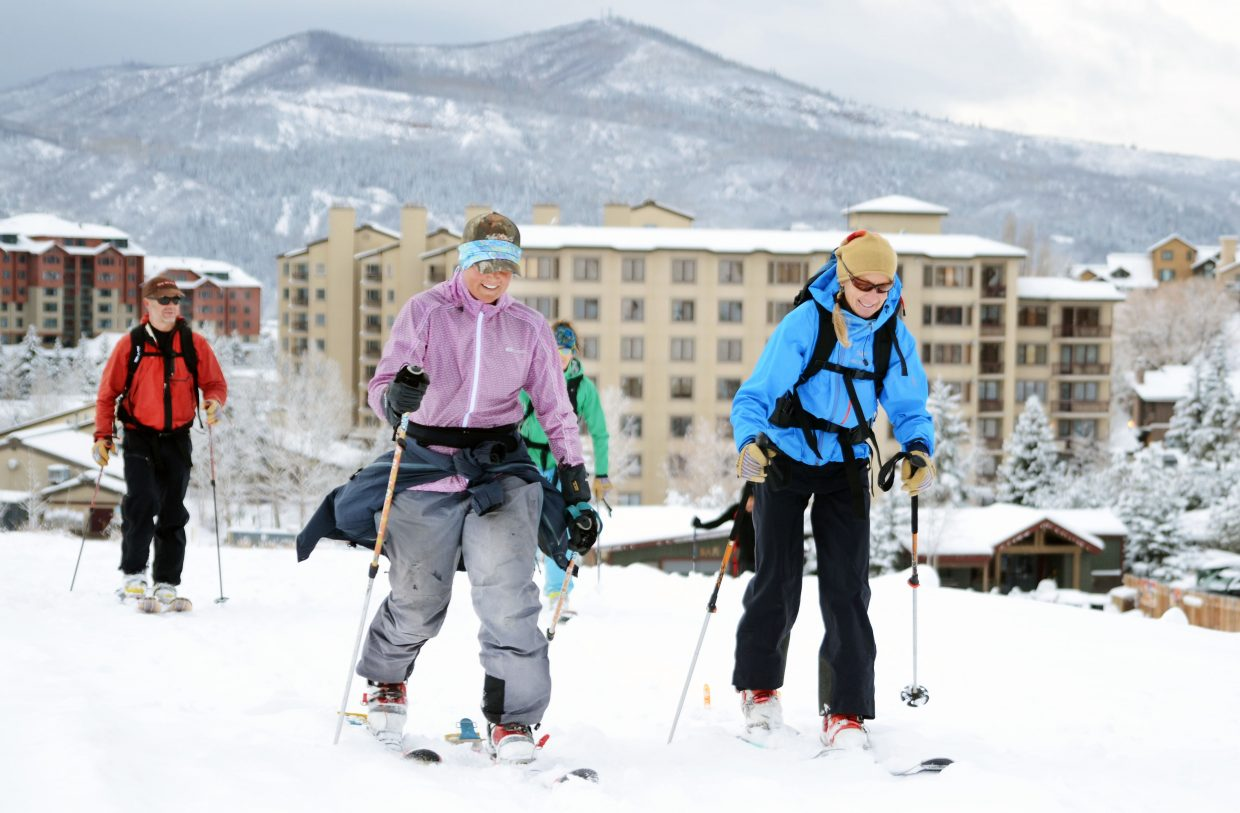 A group of skiers skins up a run at the base of Steamboat Ski Area to get in some preseason turns Sunday four days ahead of Opening Day on Thanksgiving. They weren't alone. Plenty of skiers and riders enjoyed a fresh helping of snow from Sunday's storm.