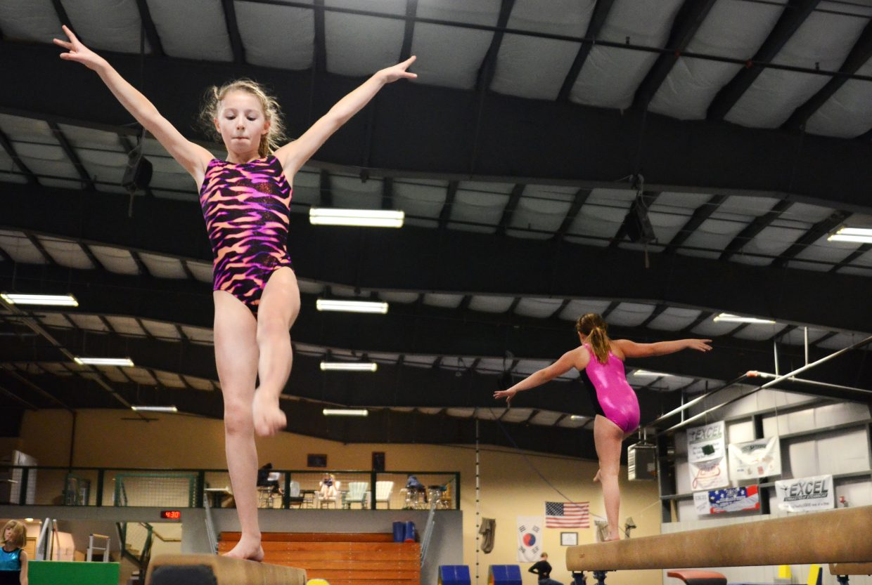 Sophia Waters, 11, warms up on the low beam Thursday in preparation for this weekend's Level 4 state championship competition on the Front Range. Waters and Excel Gymnastics of Steamboat teammates Jessica Whitecotton, 9, and Lauren Parks, 11, will head to Longmont to compete against other girls with the same season-long average competition scores. The Excel trio will be accompanied by coach Jessie Wray on Saturday and Sunday. Next weekend, Elizabeth Lemley, Kelsey Hamilton, Catcher Weynand and Elise Colby will be at the Level 3 state championship competition in Highlands Ranch. The Level 5 state championship competition is complete, and Excel's Ella Royer took 10th on the floor in her age group with a 9.125 score.