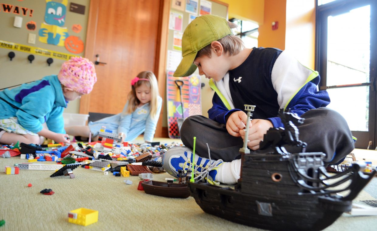 Strawberry Park Elementary School student Levi Taglioli, 8, gets to work on constructing a ship Sunday afternoon at Bud Werner Memorial Library's Lego Club. Children's Librarian Sarah Kostin said that on cold, wet days like Sunday, the Lego Club is a popular indoor event for kids of all ages.