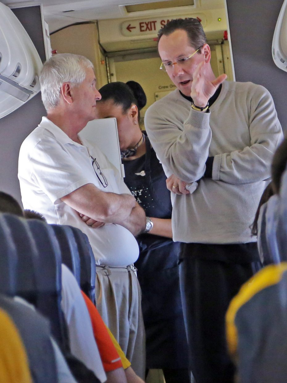 Wichita State men's basketball coach Gregg Marshall, right, and WSU President John Bardo chat on a plane flight during the 2013 NCAA tournament.
