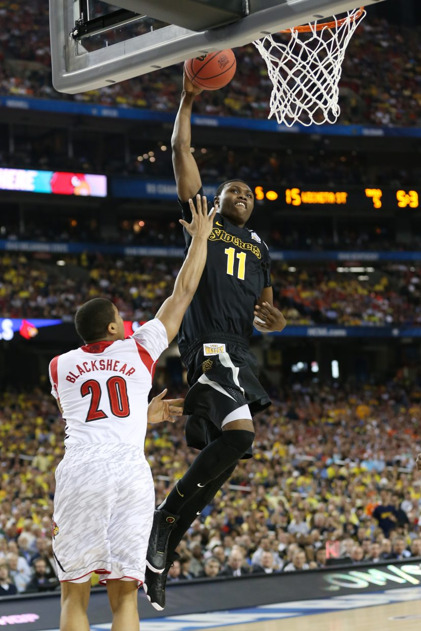 Wichita State's Cleanthony Early, right, goes up for a dunk against Louisville in the 2013 Final Four in Atlanta.