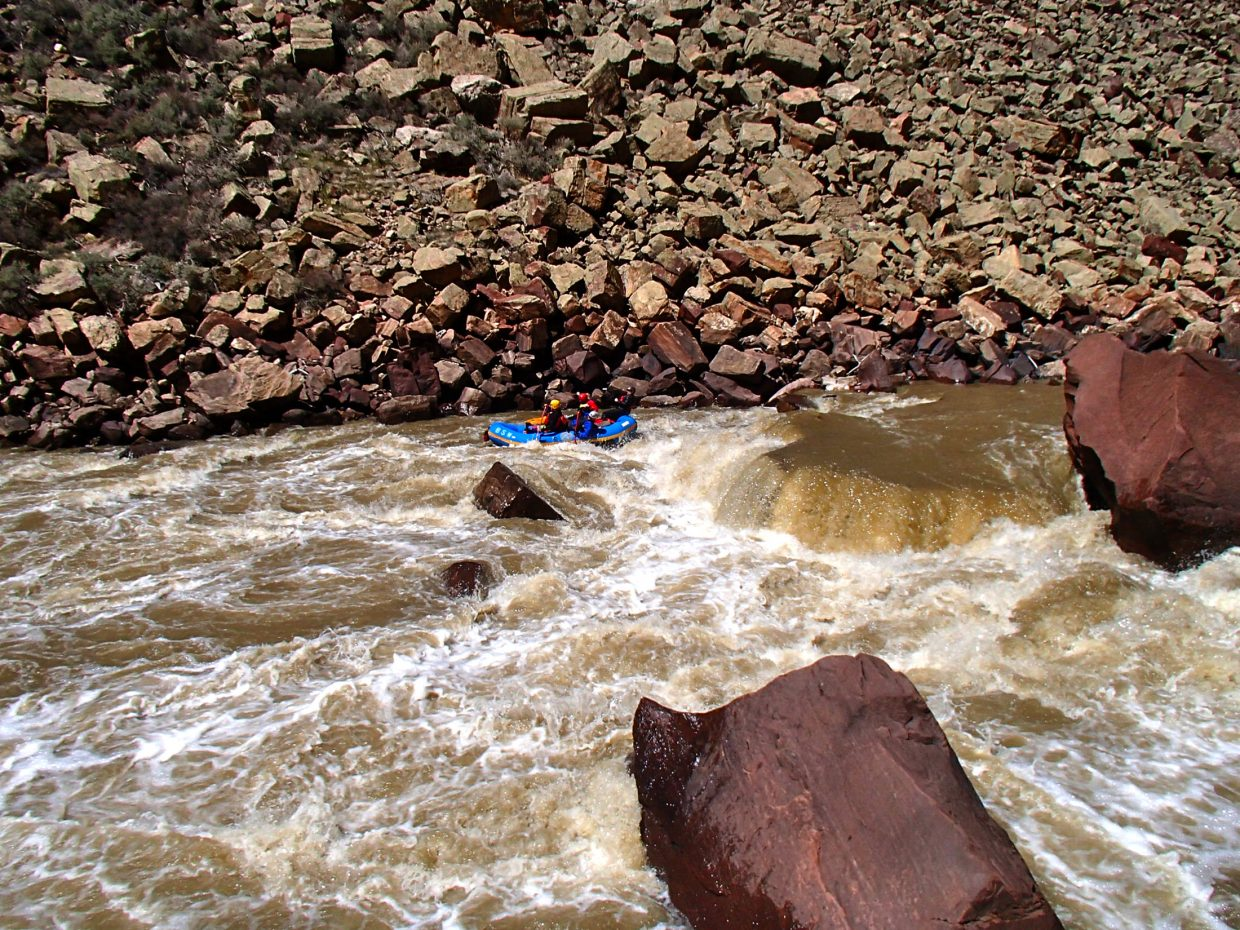 A whitewater rafting party from Steamboat Springs takes the only safe path through the boulder-strewn rapid known as Death Ferry in Cross Mountain Canyon of the Yampa River at ideal flows of 2,700 cubic feet per second April 12. As spring runoff builds later this month, it will become unsafe for rafting.