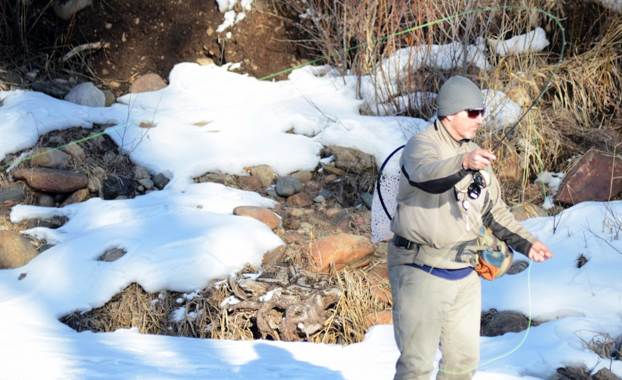 Steve Shelesky gets in a pre-Super Bowl fish Sunday afternoon along the melting banks of the Yampa River. Snow may be fading away with the abnormal weather, but the fishing is proving to be just fine, Shelesky said.