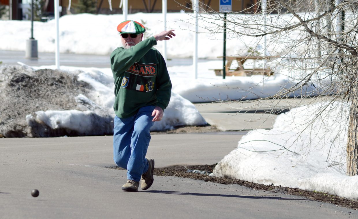 Faugh a Ballagh! Steamboat Springs' Patrick Browning tosses out a shot during the fourth edition of Irish Road Bowling outside McKnight's Irish Pub & Loft on the eve of St. Patrick's Day.