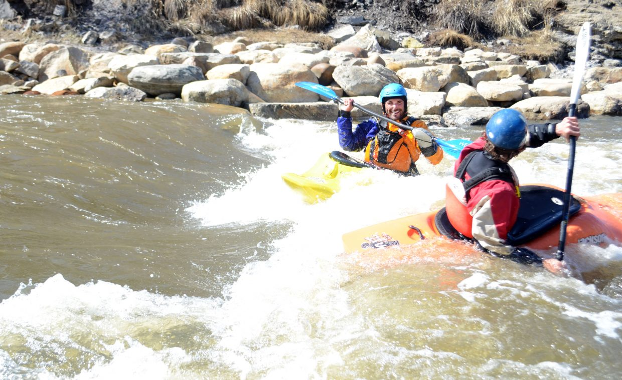 Andrew Beckler, left, and Kevin Fitch didn't mind the frigid Yampa River temperatures on a sunny Sunday. With higher-than-normal flows, the Yampa has been an early spring playground for river goers.