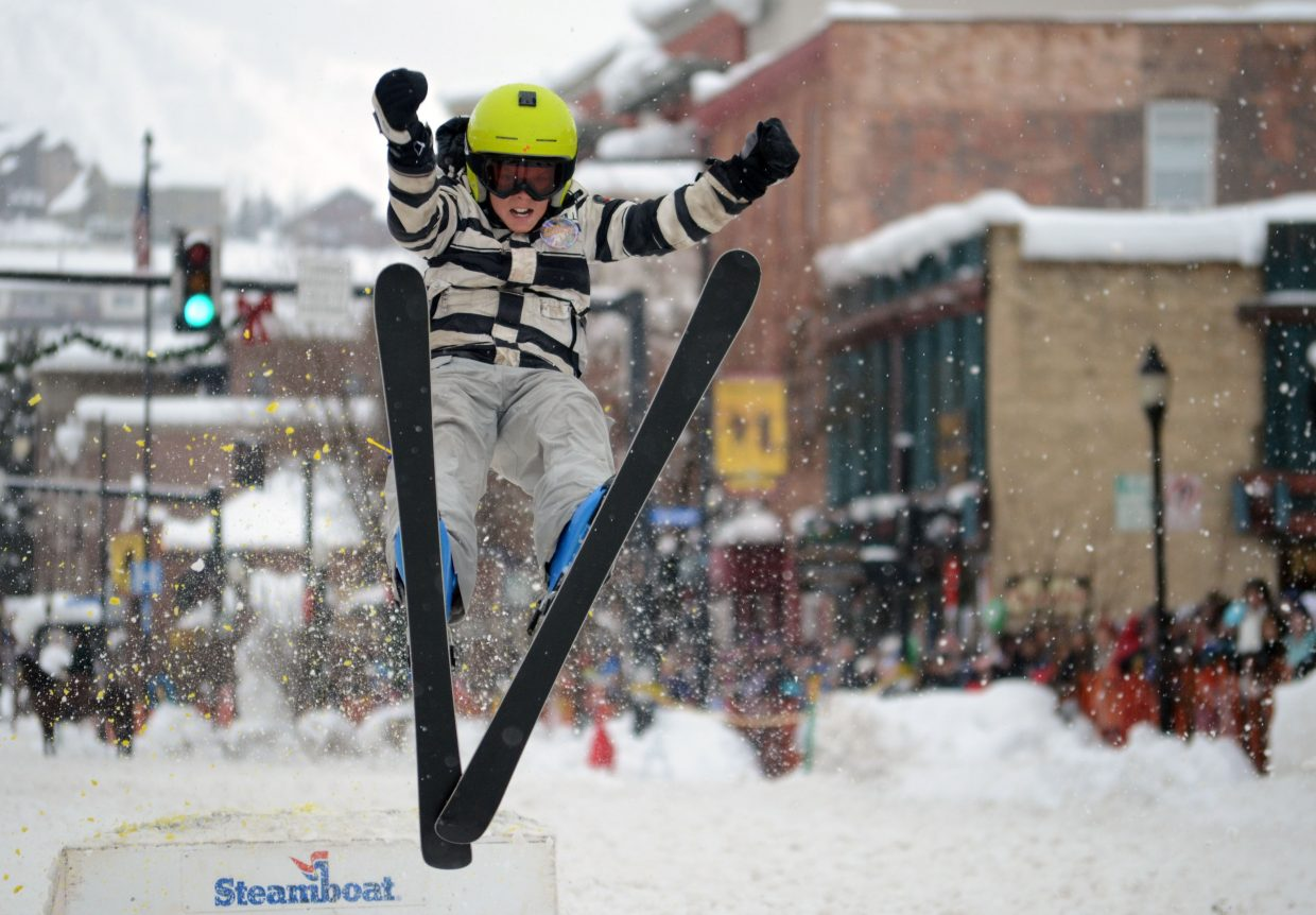 Canden Wilkinson, 11, takes flight during Sunday's donkey jump at the 101st Winter Carnival.