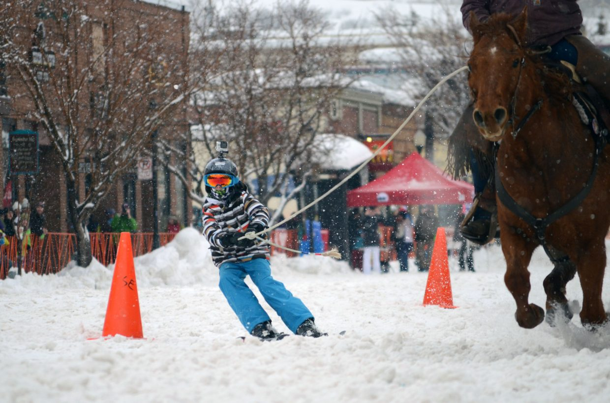 Christopher Faunce, 9, traverses the street slalom course Sunday during the 101st Winter Carnival.