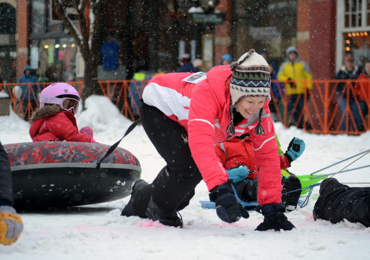 Parents switched roles with the horses for a minute Sunday as EB Kuhn pulled Elisa Cosby during the 101st Winter Carnival.