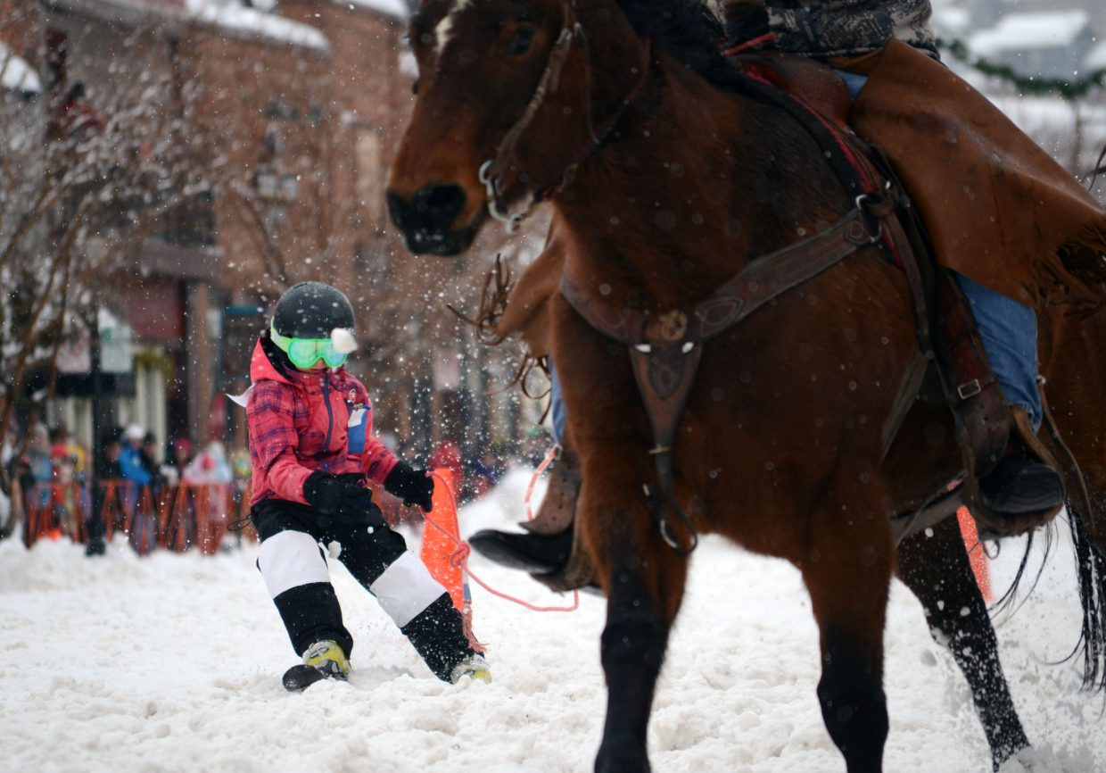 Elizabeth Lemley, 8, weaves through the street slalom course during Sunday's Winter Carnival finale.