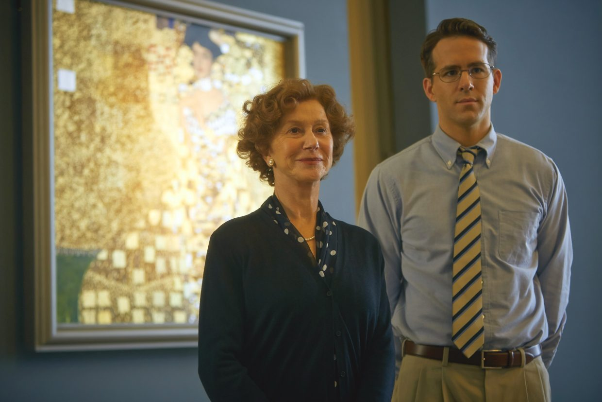 """Maria Altmann and lawyer Randy Schoenberg (Helen Mirren, Ryan Reynolds) observe a work of art in """"Woman in Gold."""" The movie is about a woman who emigrated to the United States during the Nazi occupation and seeks to reclaim artwork stolen from her family."""