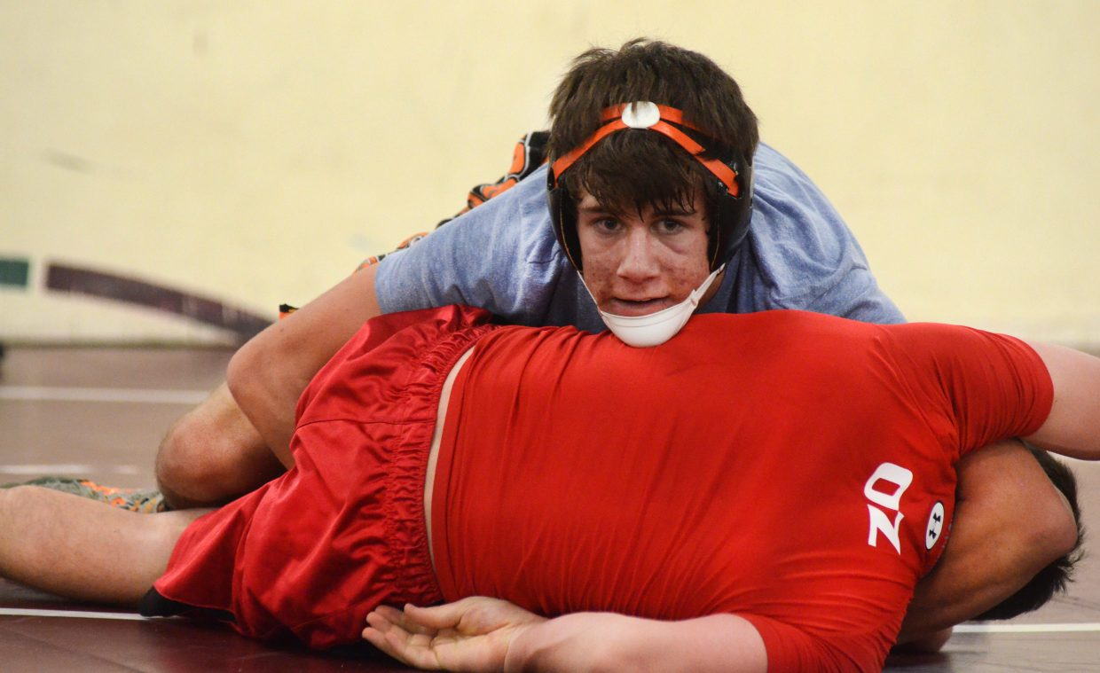 Hayden High School wrestler Tanner Guire gets a Steamboat Springs High School athlete in a strong headlock Thursday during a joint practice. Hayden and Steamboat met at Soroco's wrestling facility to hold a three-way practice, helping the athletes compete against one another and giving the coaches a chance to get a preseason Colorado High School Activities Association-mandated training out of the way.