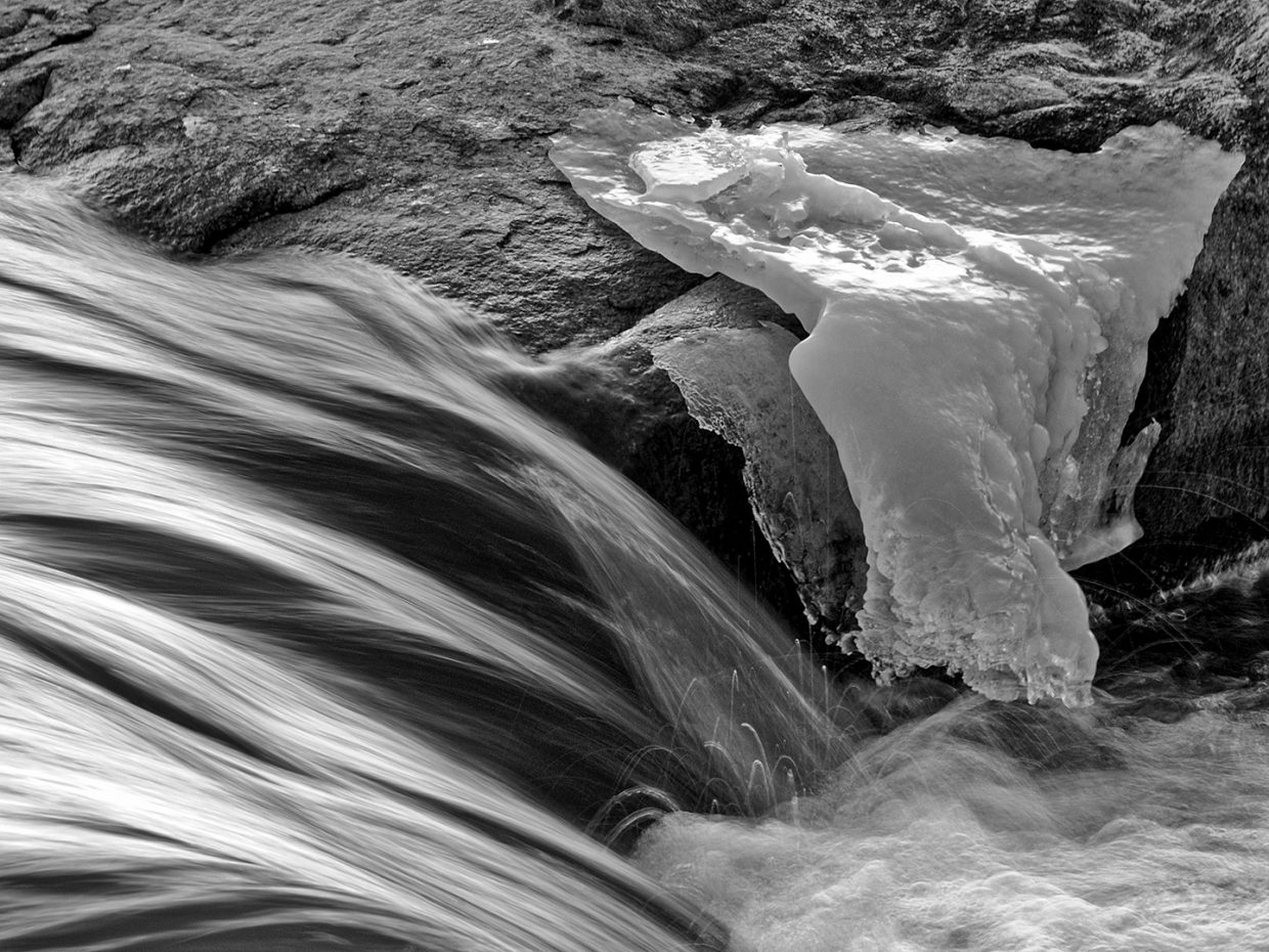 """Ice on the rocks of the Yampa River in black and white."" Submitted by Jeff Hall."