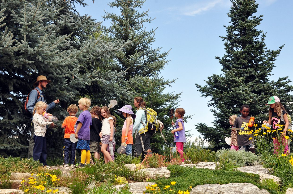 Yampatika Naturalist Tobias Bank, left, leads children on a tour of the Yampa River Botanic Park in August 2014. Yampatika is working with the Environmental Protection Agency and the Colorado Alliance for Environmental Education to offer a handful of mini-grants to groups in Northwest Colorado interested in implementing environmental literacy curriculum similar to Yampatika's.