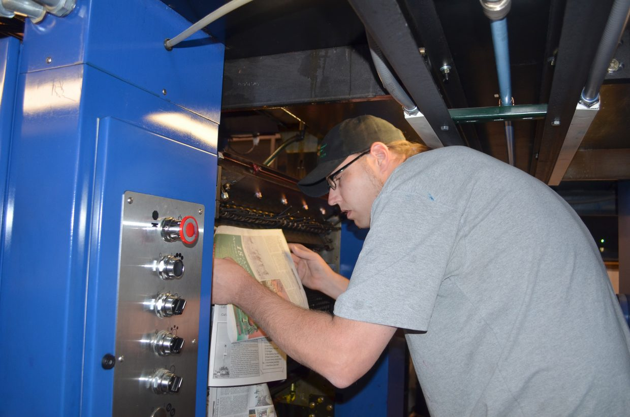 Jeremy Boyd adjusts the color keys on the press at the Steamboat Pilot & Today.