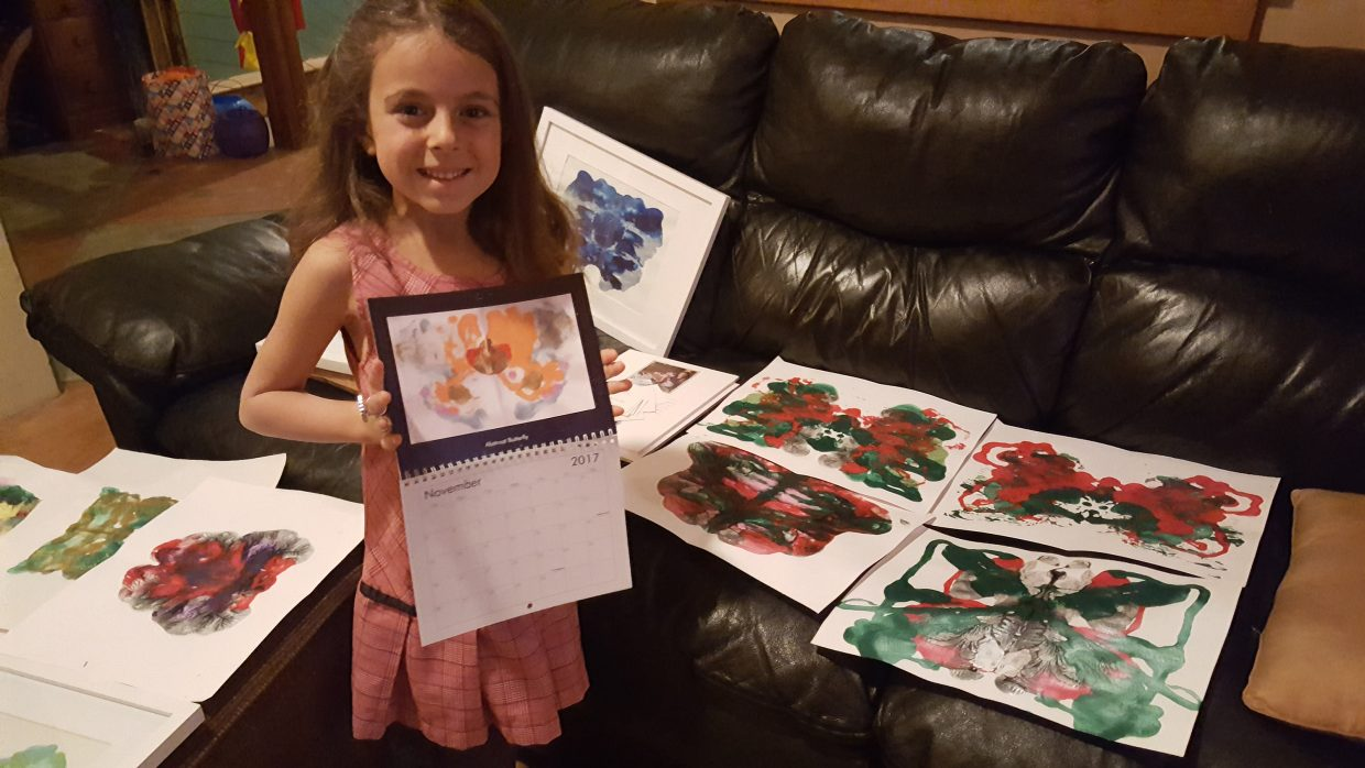 Bella Ciraldo-Freese holds her new calendar featuring her butterfly artwork. The 7-year-old will be one of the local artisans featuring her goods at the Holy Name Catholic Church bazaar from 9 a.m. to 3 p.m. Saturday at Holy Name Catholic Church on Oak Street.