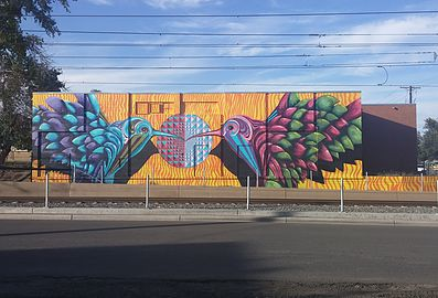 "To mitigate graffiti, the 40West Arts District in Lakewood installed a mural, ""Hear the Train a Humming"" by Bobby MaGee Lopez. The artist is creating a mural in Steamboat Springs this week."