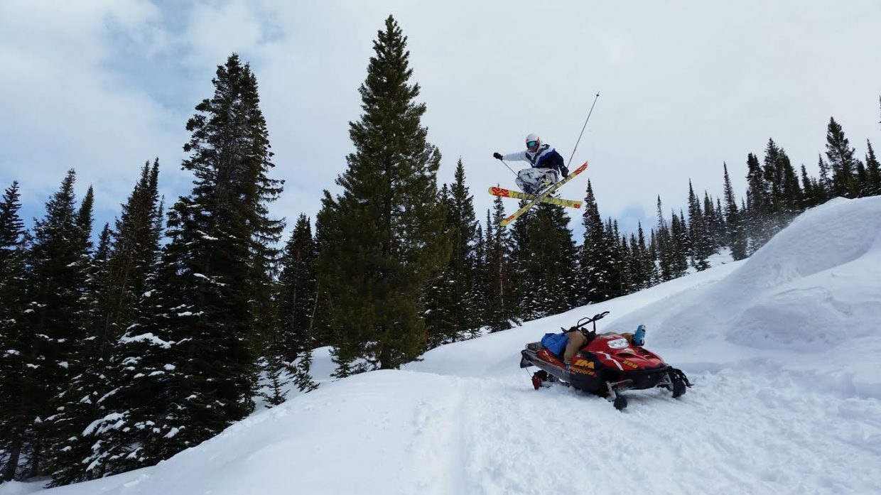 Fun on Buffalo Pass. Kerry Lofy is laying down on the snowmobile, Todd Schuster is doing the cross grab over him. Daniel Cook, CMC student, took the pic. Submitted by: Todd Schuster