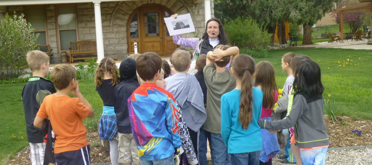 """Marianne Capra conducts a community tour with Soda Creek Elementary second graders as part of the """"My Place, My Home"""" program."""