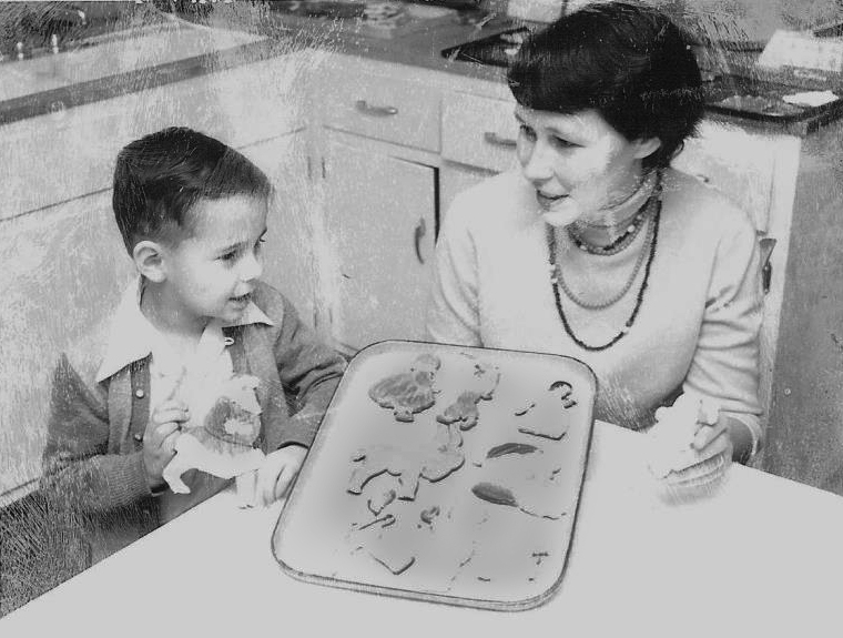 Jon Duncan Hagar, left, sits with his mom, Susan Hagar Ewing, in front of a fresh batch of the family's famous cookies. Selling the intricate cookie creations helped Ewing and her mother survive the Great Depression.