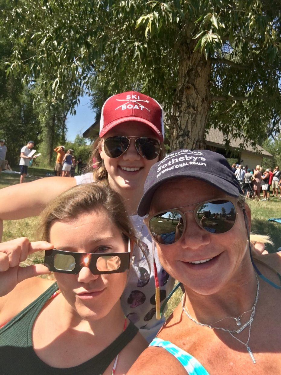 In this photo Michael, Kristy and Ali Marchand watch and wait for the Eclipse at the Yampa River State Park.