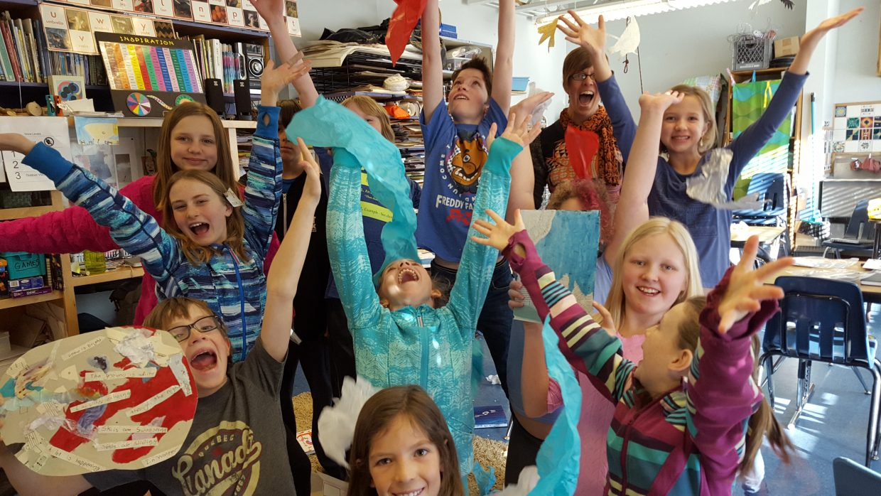 Emerald Mountain School students celebrate their artwork as they prepare for their first and only First Friday Artwalk. Students at the downtown school will display their art for the public from 5 to 7 p.m. Friday at the school during Artwalk.