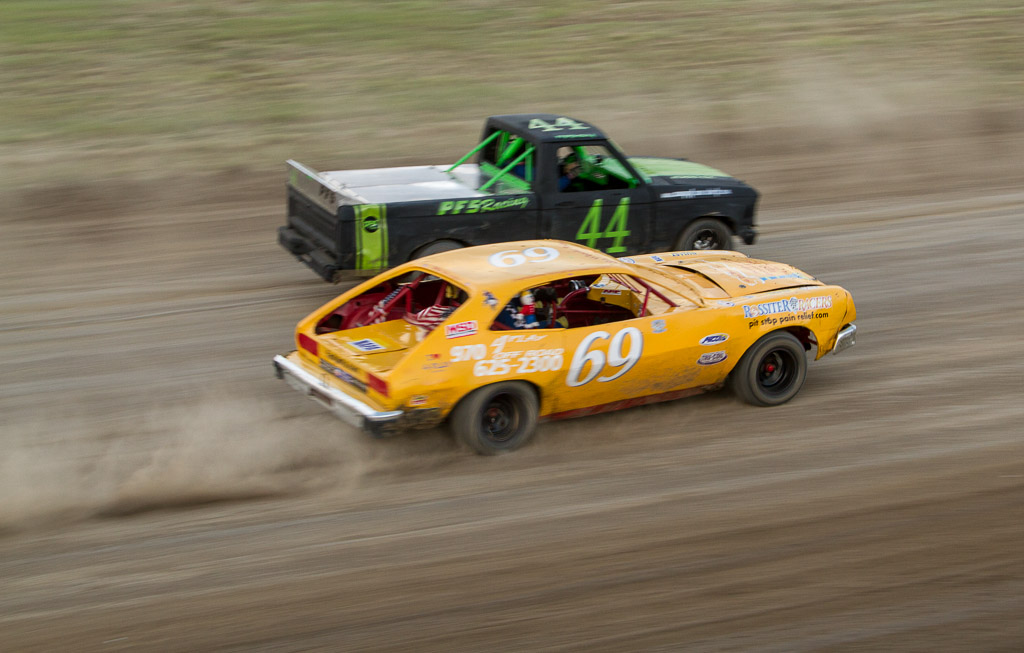 Tom Gallagher (69) of Marble moves into first place to win the Mini Class Feature Race at Hayden Speedway. Submitted by George Fargo.