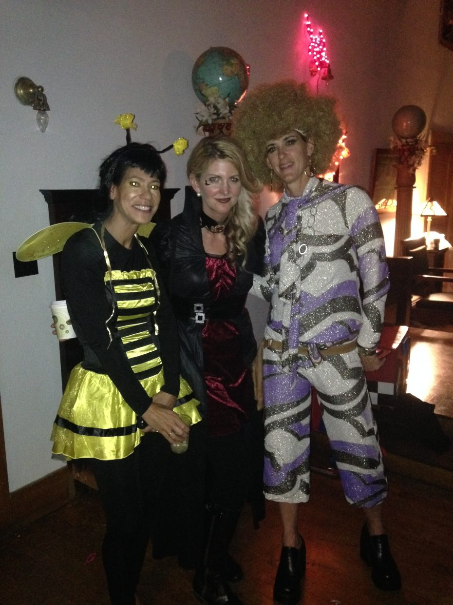 Last week at a Halloween party Danielle Hubler, Molly Hayes, and Annette Zeff pose in costume for a photo.