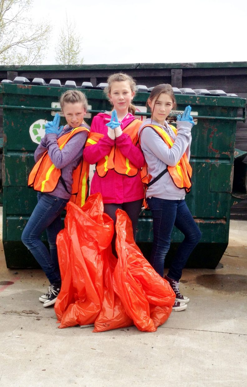 Mallory Thomas, Kira Savalox, and Emma Bessey are Clean-Up Angels on Routt County Community Clean-Up Day.