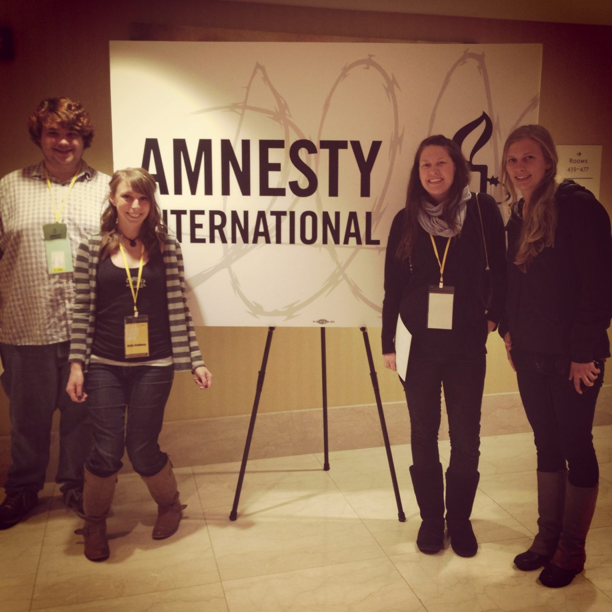 Jared Sumner, left, Molly Goldberg, Catie Jasper and Leila Wise recently attended an Amnesty International event in Chicago where Edward Snowden and Glenn Greenwald spoke via Skype. Goldberg is helping host a benefit for Amnesty International on Friday at Old Town Pub.