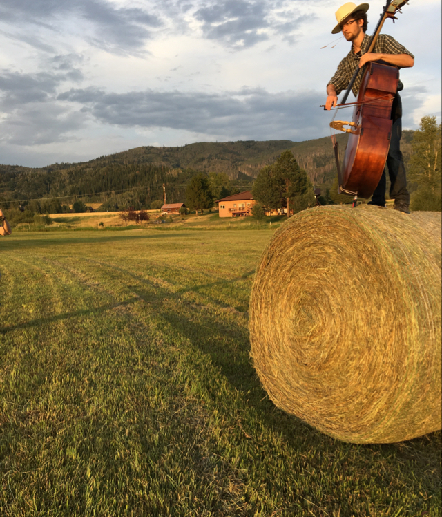 Andy Sproule from Denver played the bass for the recent Opera Steamboat performances.  This is a photo of him having some fun on a hay bale in Strawberry Park last week.