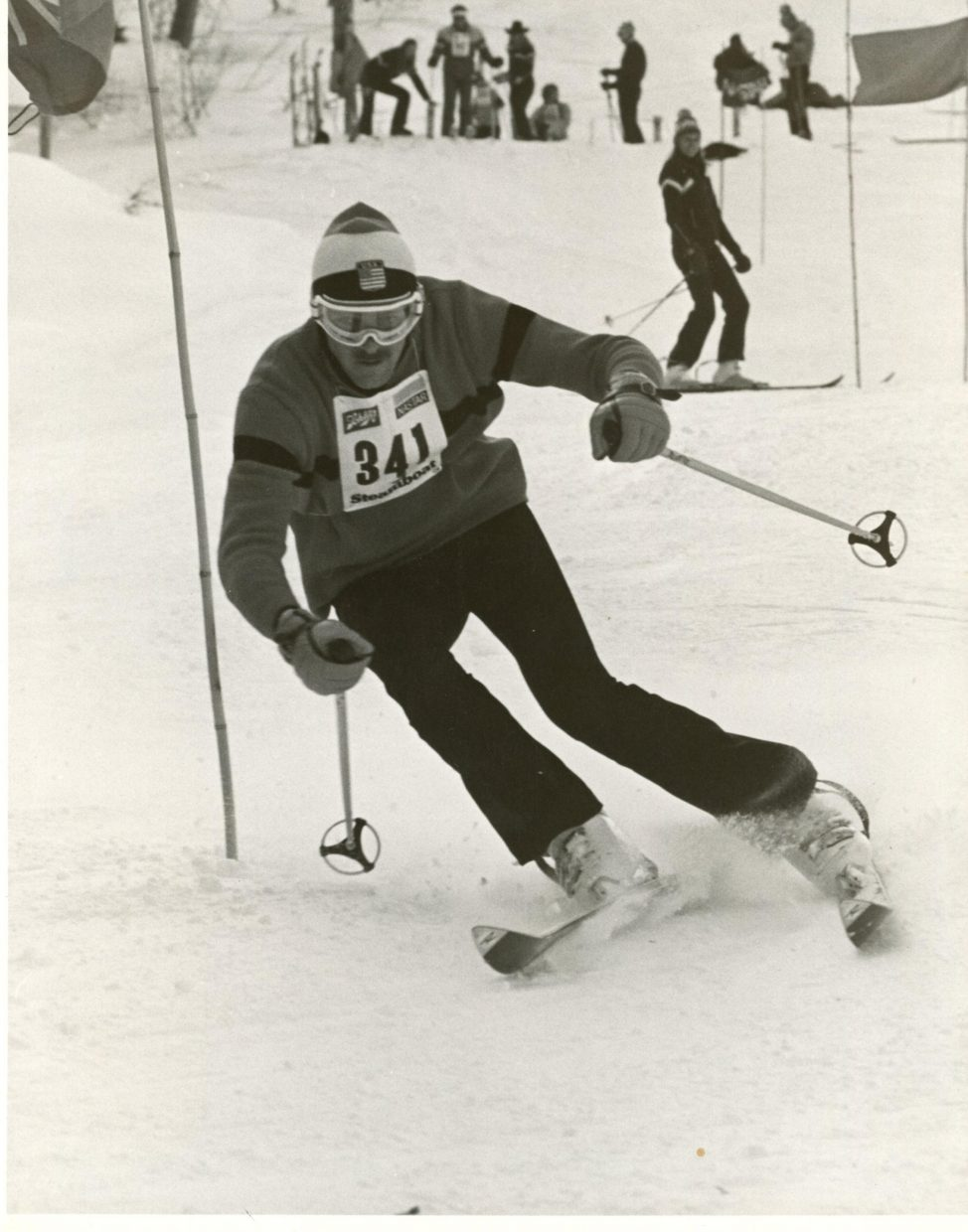 Early years racing at Howelson. Photo taken possibly in 1975. A group of us raced nights, and this picture was during Winter Carnival, during a race series that preceeded Town Challenge. I was second in this race, Chuck Stoughton, who owned a ski shop was third, and I can't remember who won. Submitted by Dr. Joihn Sharp.