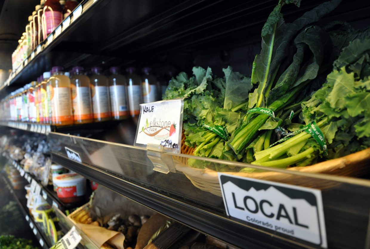 """Bunches of kale grown in the Yampa Valley sit on a shelf at Bamboo Market in 2013. August's statewide """"Colorado Proud"""" campaign encourages residents to eat more foods grown or produced in Colorado."""